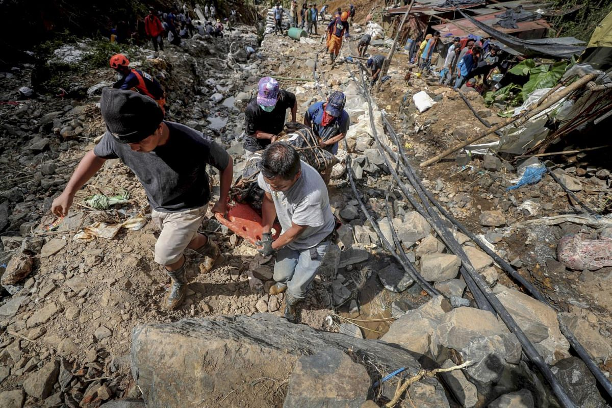 One of the victims found after being buried in a landslide caused by Super Typhoon Mangkhut in Ucab village, Itogon, the Philippines, on Sept 18, 2018.