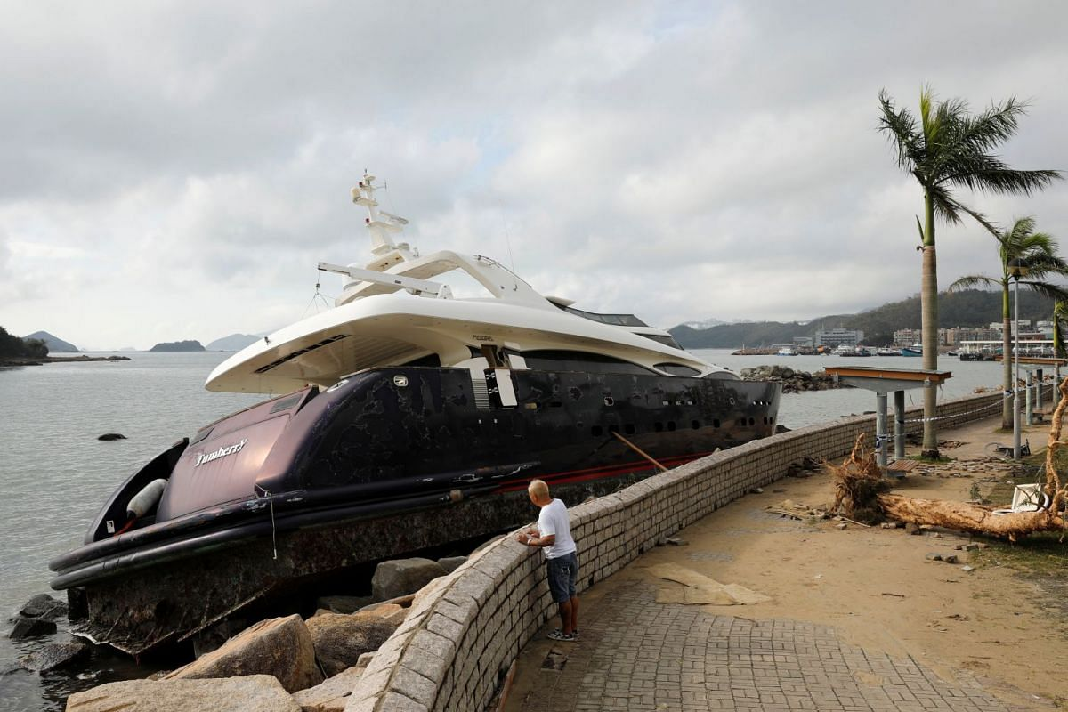 A yacht is seen moved onto the seawall on Sept 18, 2018, after Super Typhoon Mangkhut hit Hong Kong.