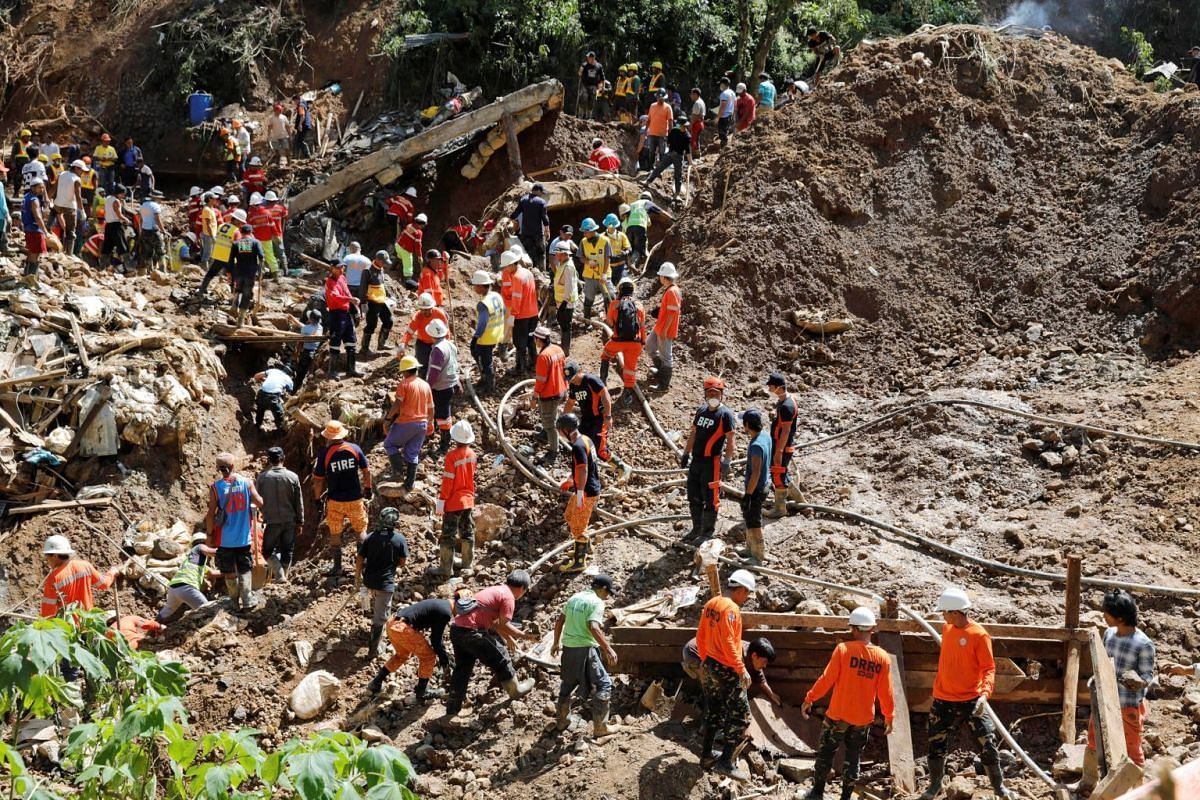 Rescuers continue their search for missing miners in a landslide caused by Typhoon Mangkhut at a mining camp in Itogon, the Philippines, on Sept 18, 2018.