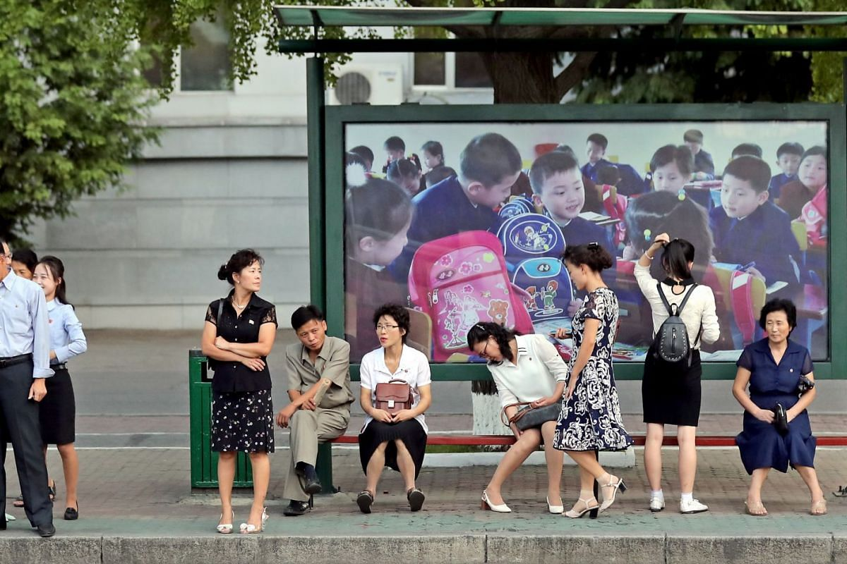 North Korean people wait for public transport in Pyongyang, North Korea, on Sept 18, 2018.