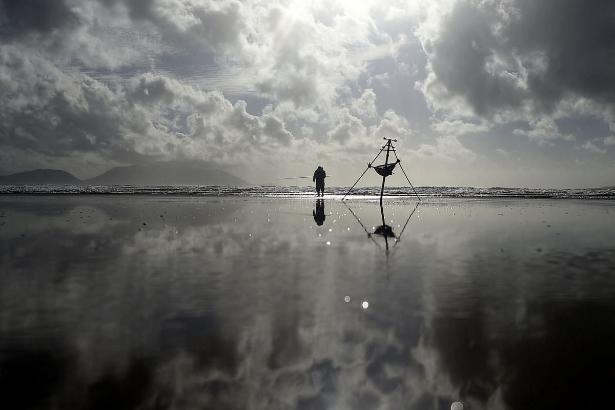 A man participates in the Diawa Irish Pairs sea angling event in windy conditions on the Dingle Peninsula of Inch beach in Inch, Ireland, September 18, 2018. PHOTO: REUTERS