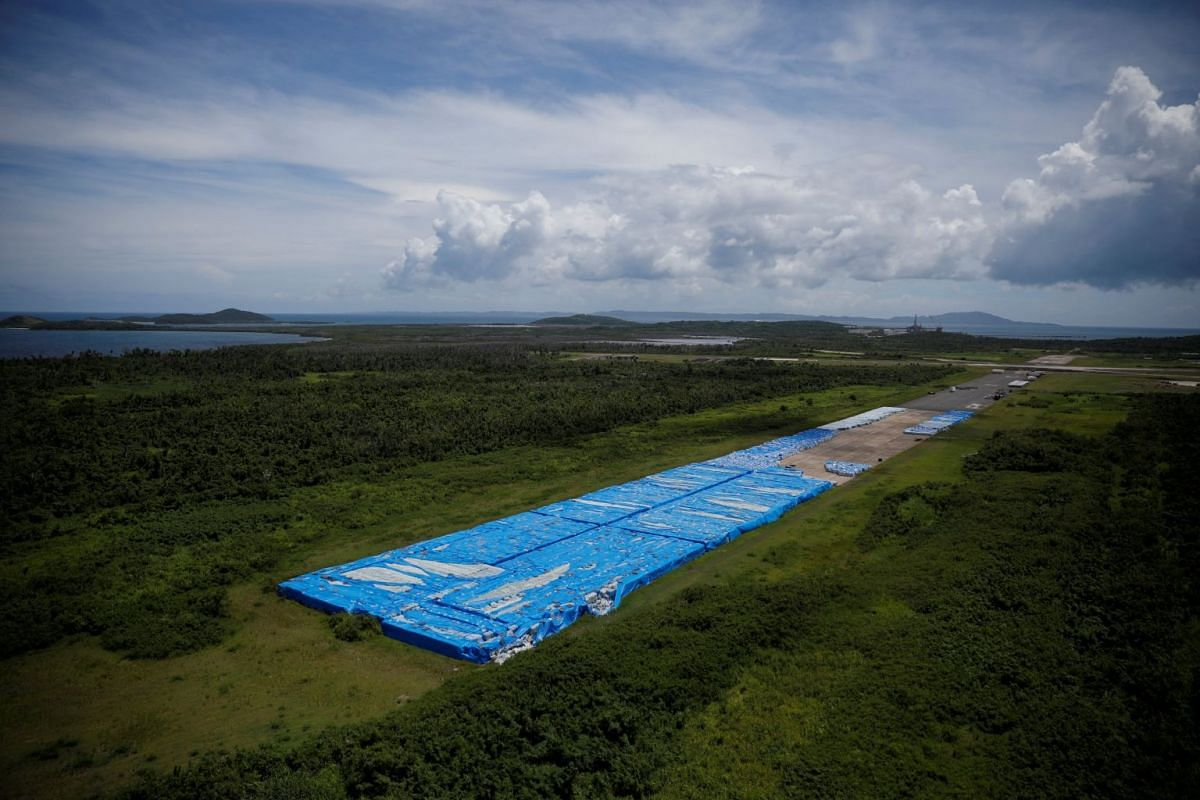 About 20,000 pallets of unused water bottles are seen along an airplane runway a year after Hurricane Maria devastated Puerto Rico in Ceiba, Puerto Rico, September 18, 2018. Picture taken September 18, 2018. PHOTO: REUTERS