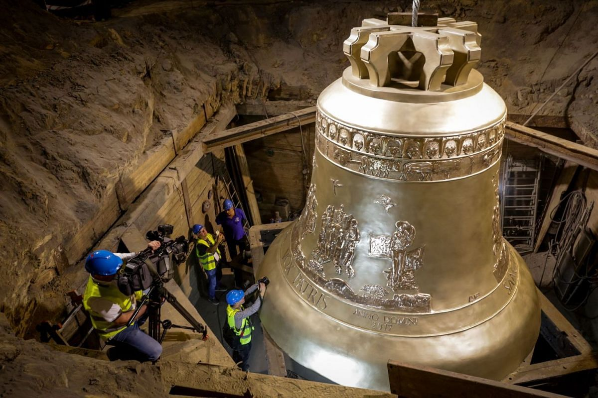 A handout picture released by the communication services of the foundry in Przmysl shows the world's largest bell, weighing 55 tons, during its unveiling ceremony on September 20, 2018 at the Metalodlew foundry in Krakow. PHOTO: FOUNDRY PRESS OFFICE