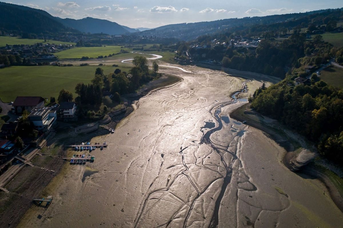 An aerial view shows the dried out bed of Brenet Lake (French: Lac des Brenets) part of the Doubs river, a natural border beetwen eastern France and western Switzerland, on September 20, 2018 in Les Brenets. PHOTO: AFP