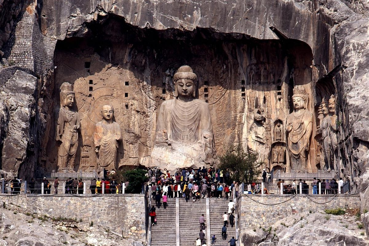 Fengxian Temple (left), a cluster of nine massive sculptures spread out across a 40m niche, is the piece de resistance of the Longmen Grottoes (above). The Tiantang hall (above) was used for religious ceremonies and stands at an auspicious 88.88m, th