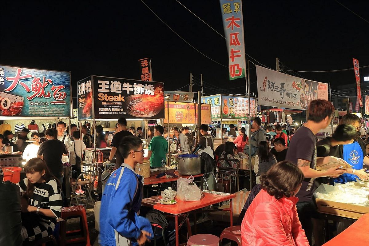 The Tainan flower night market (above), which also offers street food. However, the city also offers interesting yet traditional fare, such as milkfish congee and danzai noodles.