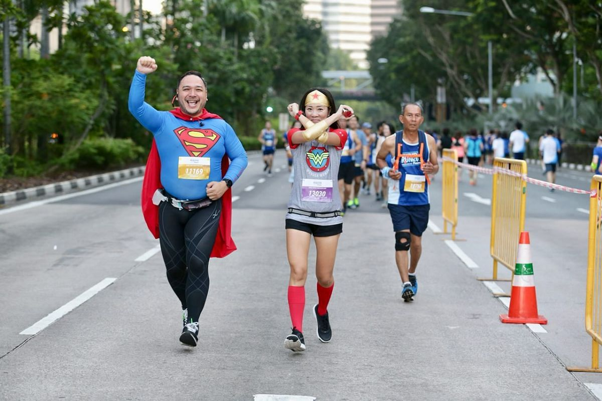 """""""Superheroes"""" join in the 10km run along Nicoll Highway."""