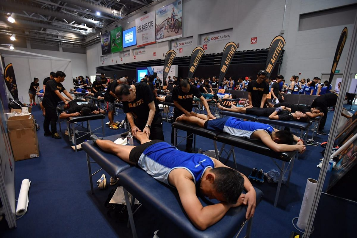 Runners from the 18.45km and 10km categories get post-race massages provided by Tiger Balm at the OCBC Arena Hall 1.