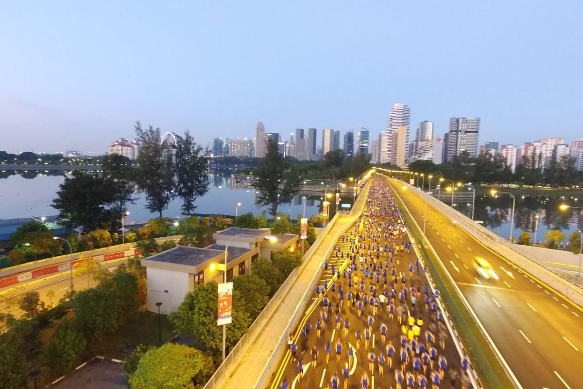 Participants of the 10km race running along Nicoll Highway.