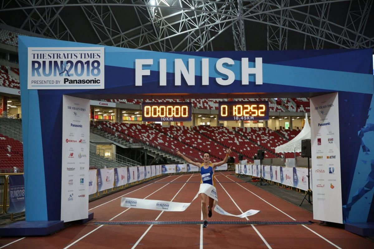 Ben Moreau, the first 18.45km runner, crosses the finish line at the National Stadium in slightly over an hour.