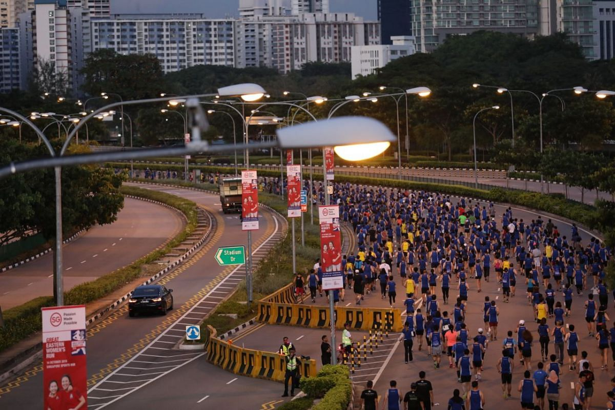 Participants are flagged off for the start of the 10km run along Nicoll Highway.