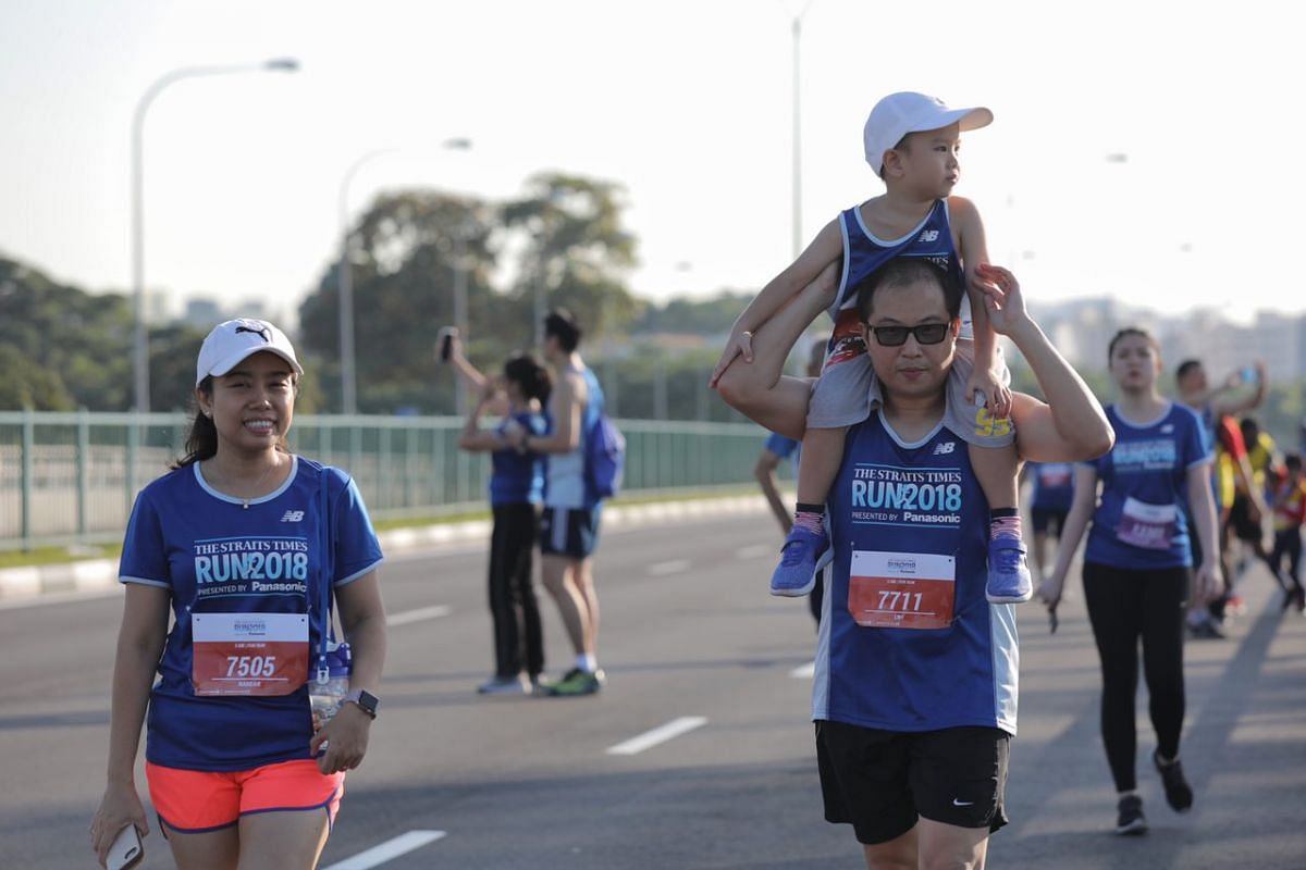 Five-year-old Nanda Lim takes a ride on his father Lim Wee Fong's, 39, shoulders as the family, with mother Nandar Aye, 41, traverses Merdeka Bridge during the 5km fun walk.