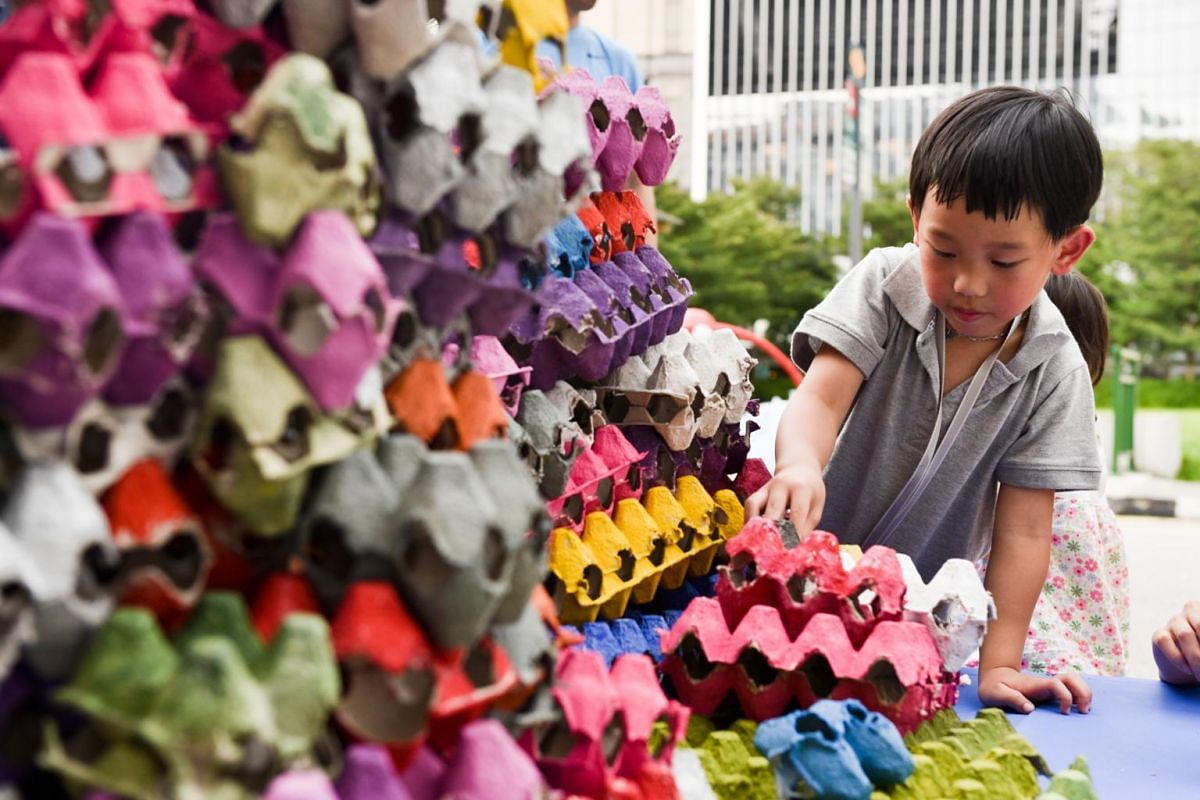 Royce Chan, five, spent almost an hour at the Build-A-Tama booth by Pioneer Junior College as he enjoys building things.