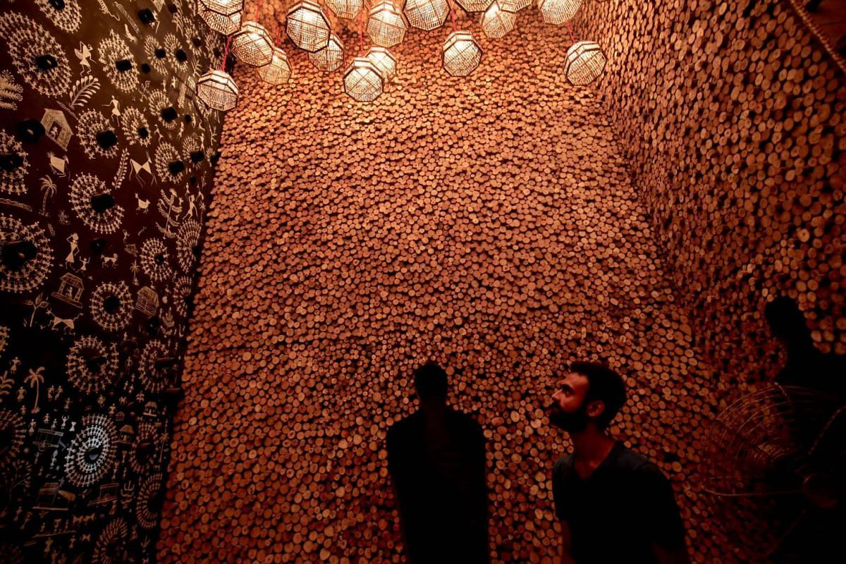 Indian artists work on a makeshift pandal made with wood, fiber, metal and bamboo by artist Anirban Das in Kolkata, India, on Sept 23, 2018.