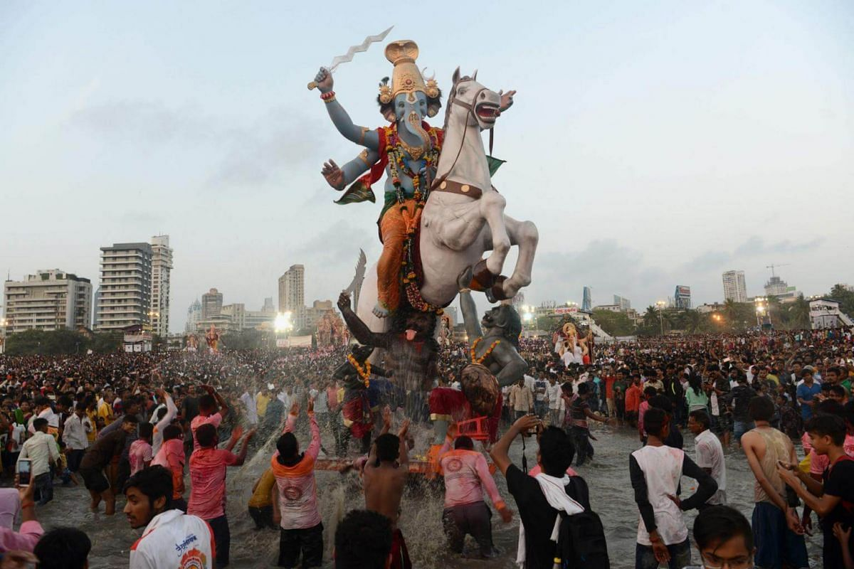 Indian devotees carry a statue of Hindu god Lord Ganesha for immersion in the Arabian sea in Mumbai, on Sept 23, 2018.