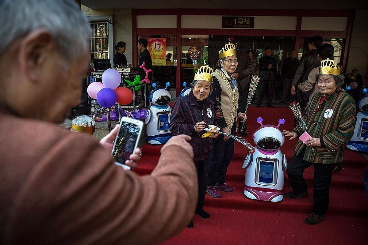 Robots at the City Social Welfare Centre in Hangzhou. China is in a big hurry to develop its robotics capabilities because of an ageing population and a slowing birth rate.