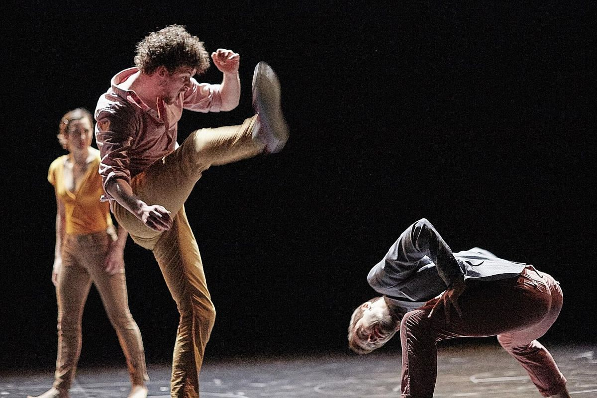 """The """"violence"""" in dance performance Joy (left) is achieved by the careful angling of bodies, the exaggerated expressions of pain and sound effects from the sidelines."""