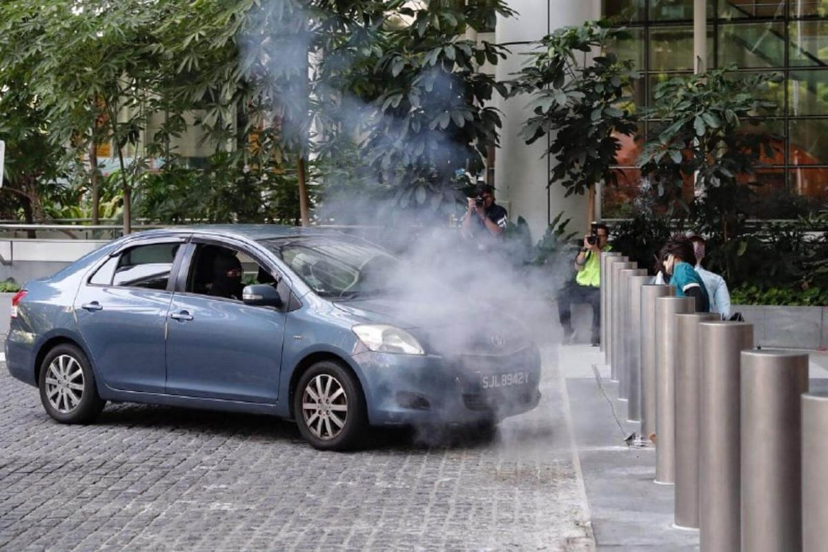 """A vehicle driven by masked attackers """"crashes"""" into bollards during Exercise Heartbeat at the National Library on Sept 25, 2018."""