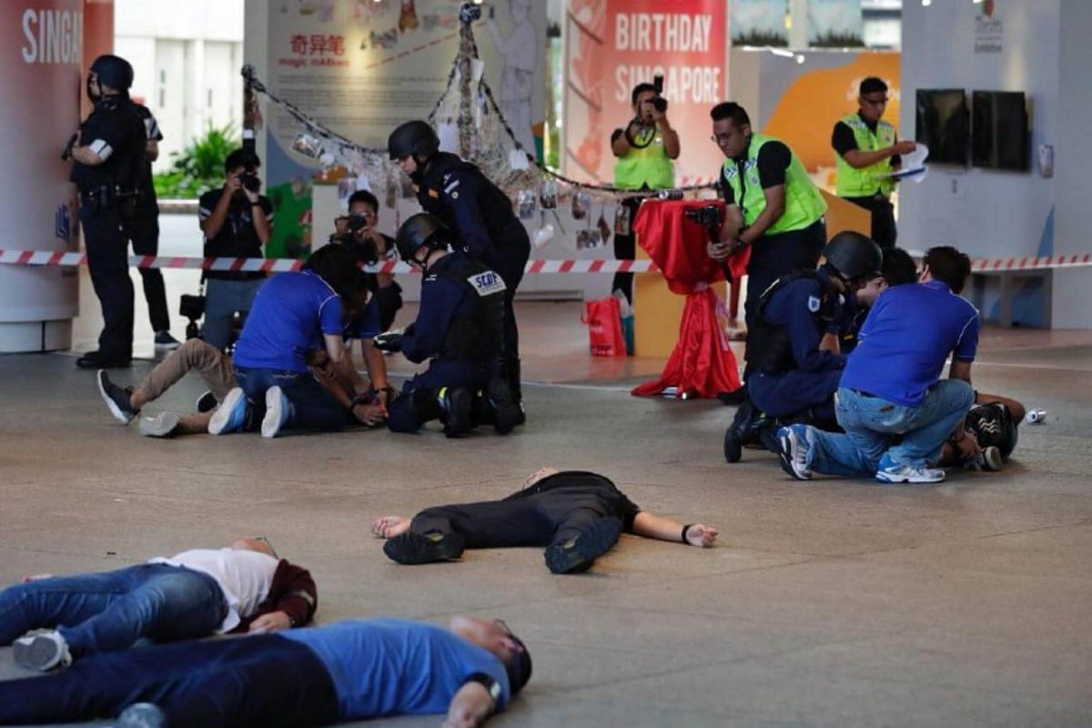 National Library Board staff (in blue) render aid to casualties as SCDF officers arrive during Exercise Heartbeat at the National Library on Sept 25, 2018.