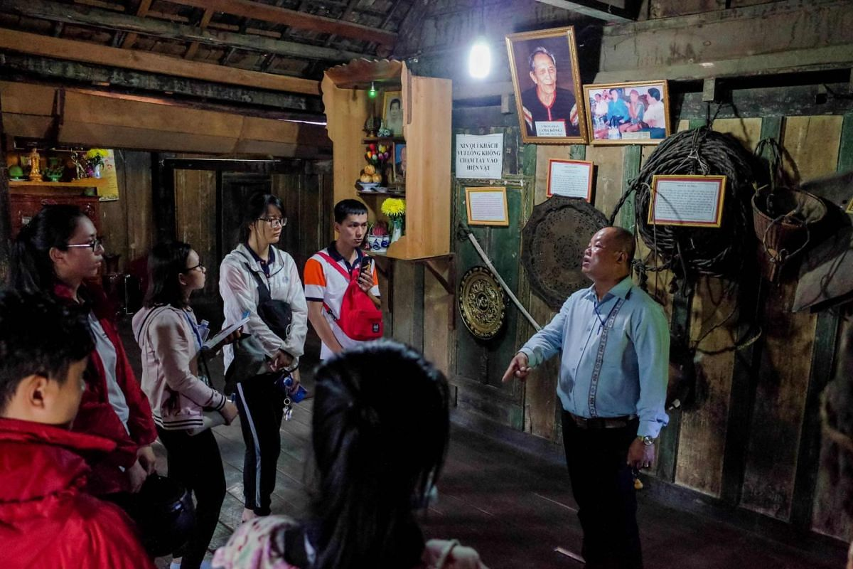 Visitors view the traditional home of the late Ama Kong, a legendary elephant tamer from the M'nong tribe, in Buon Don district, Dak Lak province.
