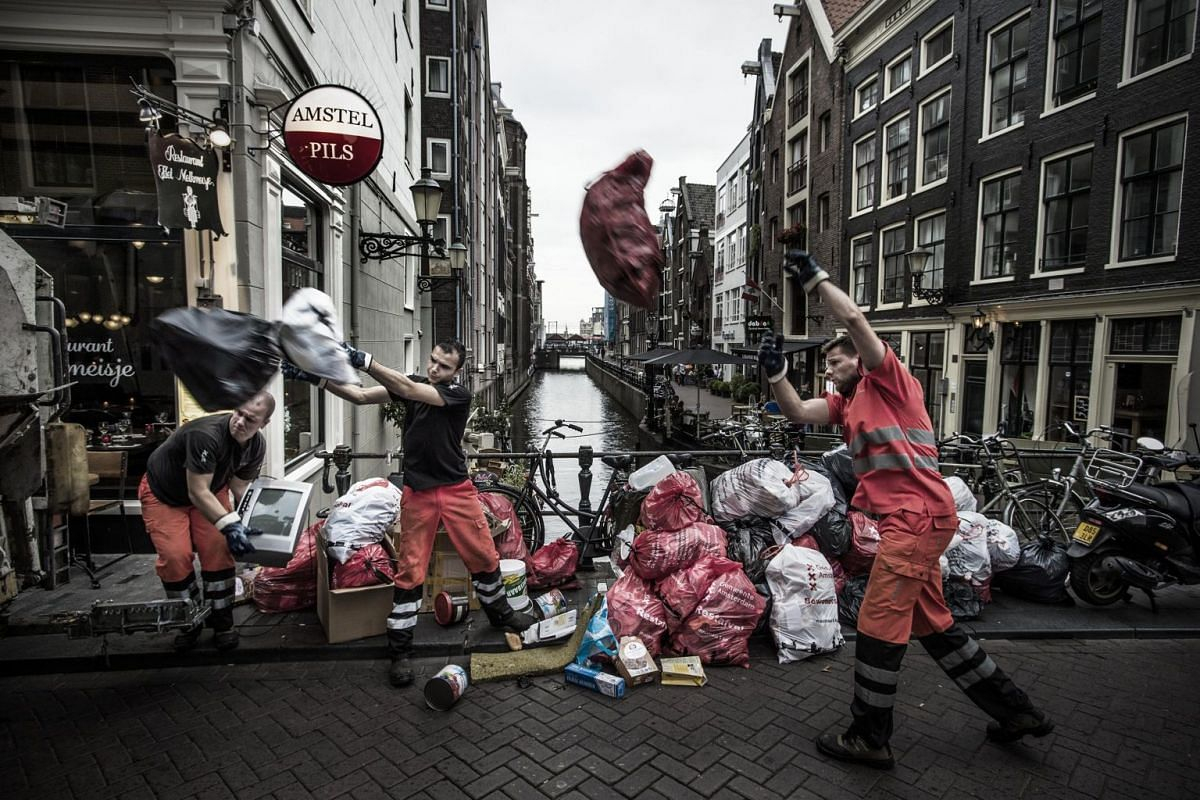 Garbage is collected in the center of Amsterdam, the Netherlands, July 9, 2017. In most neighborhoods of the city, garbage is deposited in underground containers to await removal, but in some parts of the historic center it is still left on the stree
