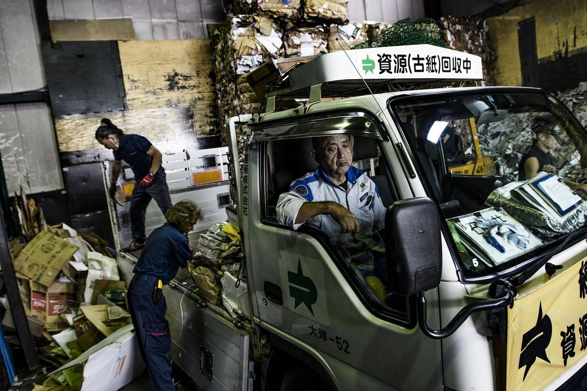 Waste is unloaded at Shizai paper recycling plant, which has been processing waste since 1969, in Tokyo, Japan, on Aug 23, 2017.