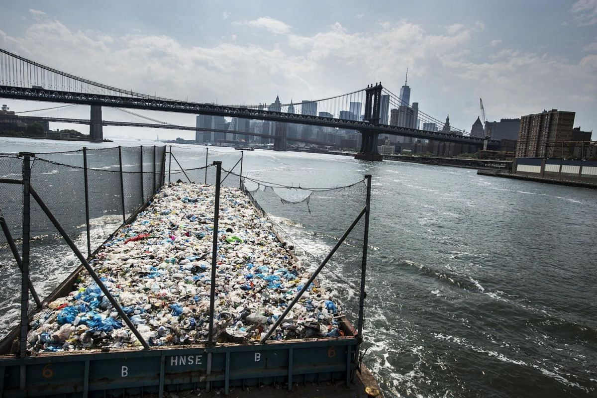 A barge with more than 300 tonnes of mainly plastic is on its way from the Bronx to a recycling plant in Brooklyn, New York, USA, on May 26, 2016. Until the mid-1990s, New York's primary method of disposing of waste was to dump it at sea.