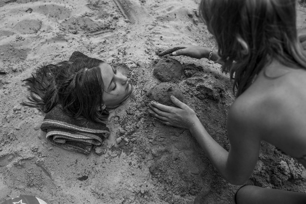 Alena and Steffi play in the sand, on July 16, 2014.
