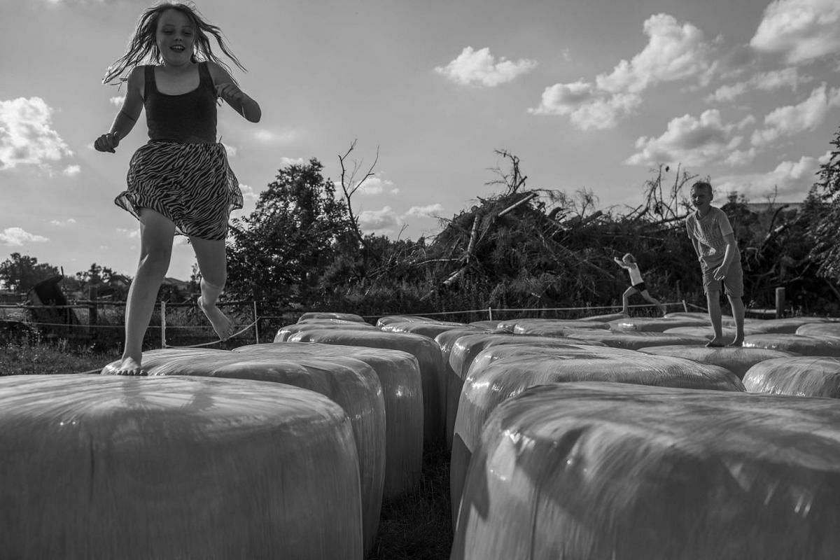 Hannah and Dominik play in the fields, on July 20, 2016.