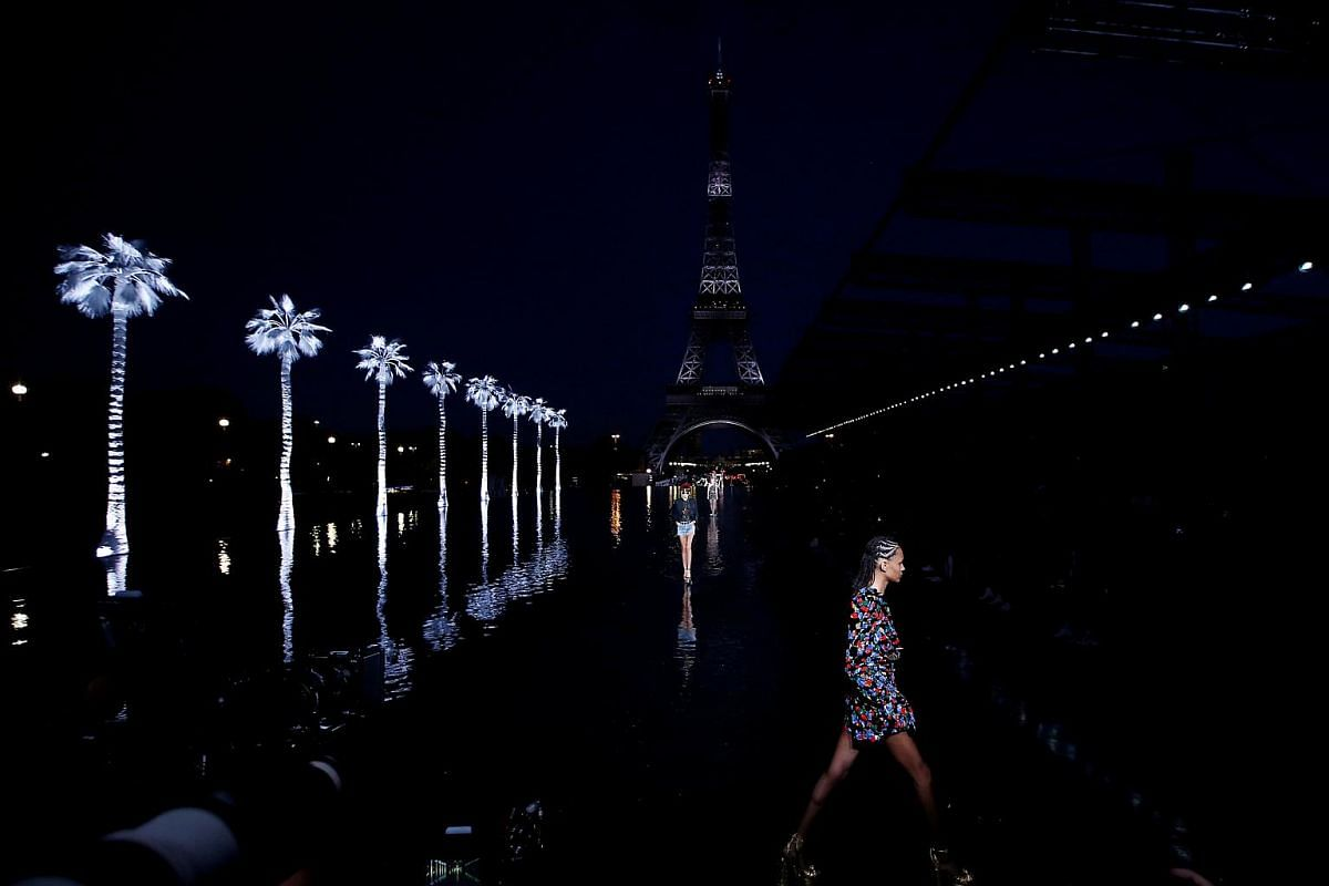 Models present creations by designer Anthony Vaccarello as part of his Spring/Summer 2019 women's ready-to-wear collection show for fashion house Yves Saint Laurent during Paris Fashion Week in Paris, France, on Sept 25, 2018.