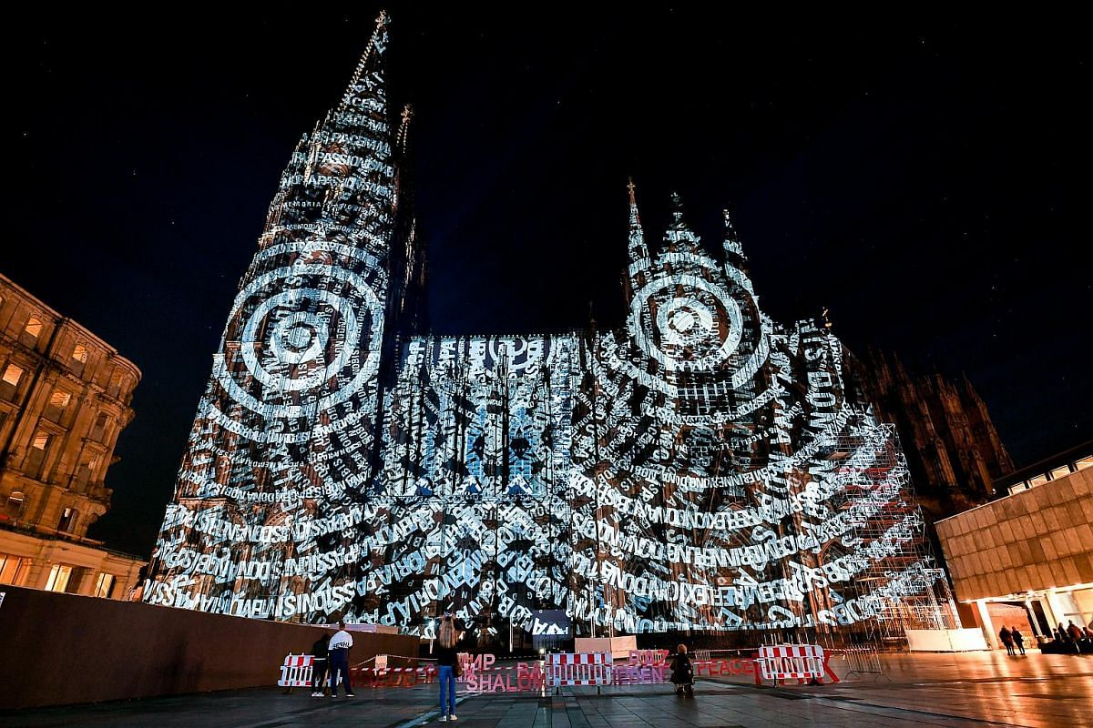 Various designs are projected on the facade of the Cathedral in Cologne, Germany, on Sept 25, 2018, to commemorate the end of World War I 100 years ago in 1918.