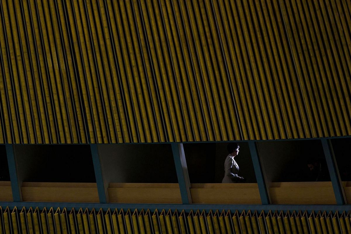 A television reporter speaks to the camera during the General Debate of the General Assembly of the United Nations at the UN headquarters in New York, on Sept 25, 2018.