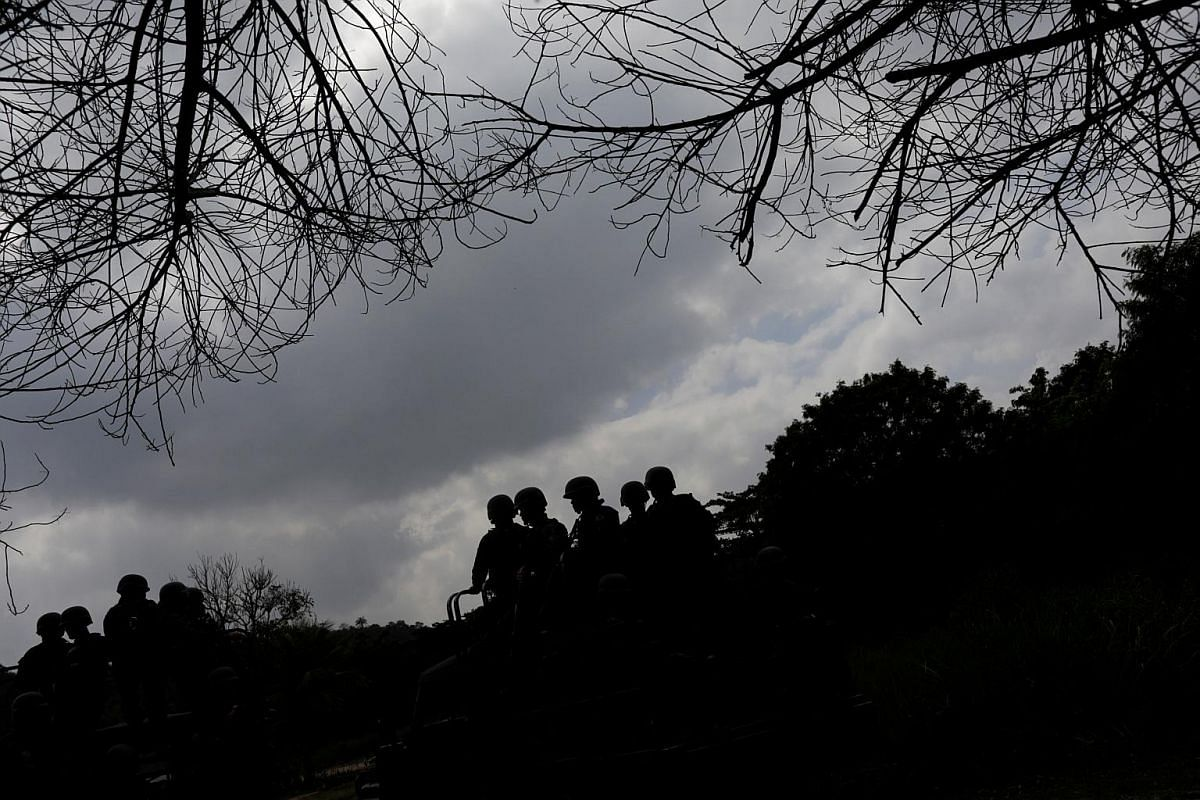 Brazilian soldiers patrol during an operation against drug gangs in Salgueiro slums complex in Sao Goncalo, Brazil, on Sept 25, 2018.