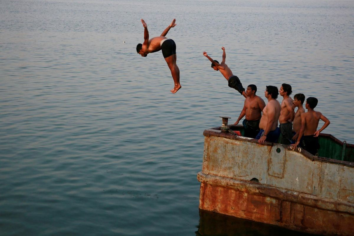 Iraqi boys swimming in the Shatt al-Arab in Basra, Iraq, on Sept 9, 2018. Basra residents say salt seeping into the water supply has made it undrinkable and sent hundreds to a hospital.