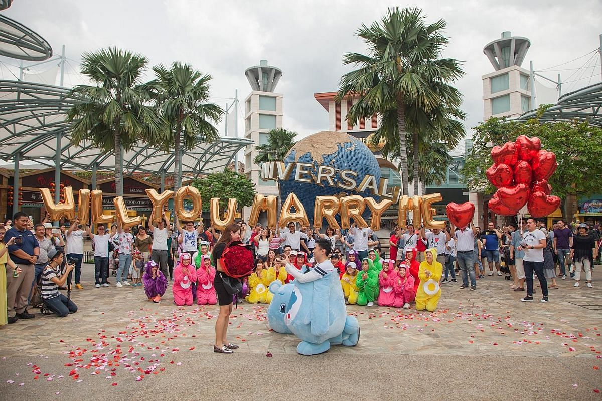 Mr Andrew Ho proposed to Ms Anna Phua (both above) publicly in a large-scale event last year involving flash mobs, dancing and Care Bears, her favourite cartoon, at Resorts World Sentosa here. Mr Jay Tay proposed to Ms Teng Hui Li at a beach in Bali