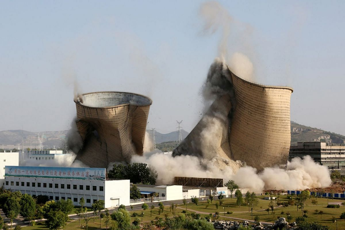 Cooling towers collapse during a controlled demolition at Huadian Shiliquan power plant in Zaozhuang, Shandong province, China, Sept 29, 2018.