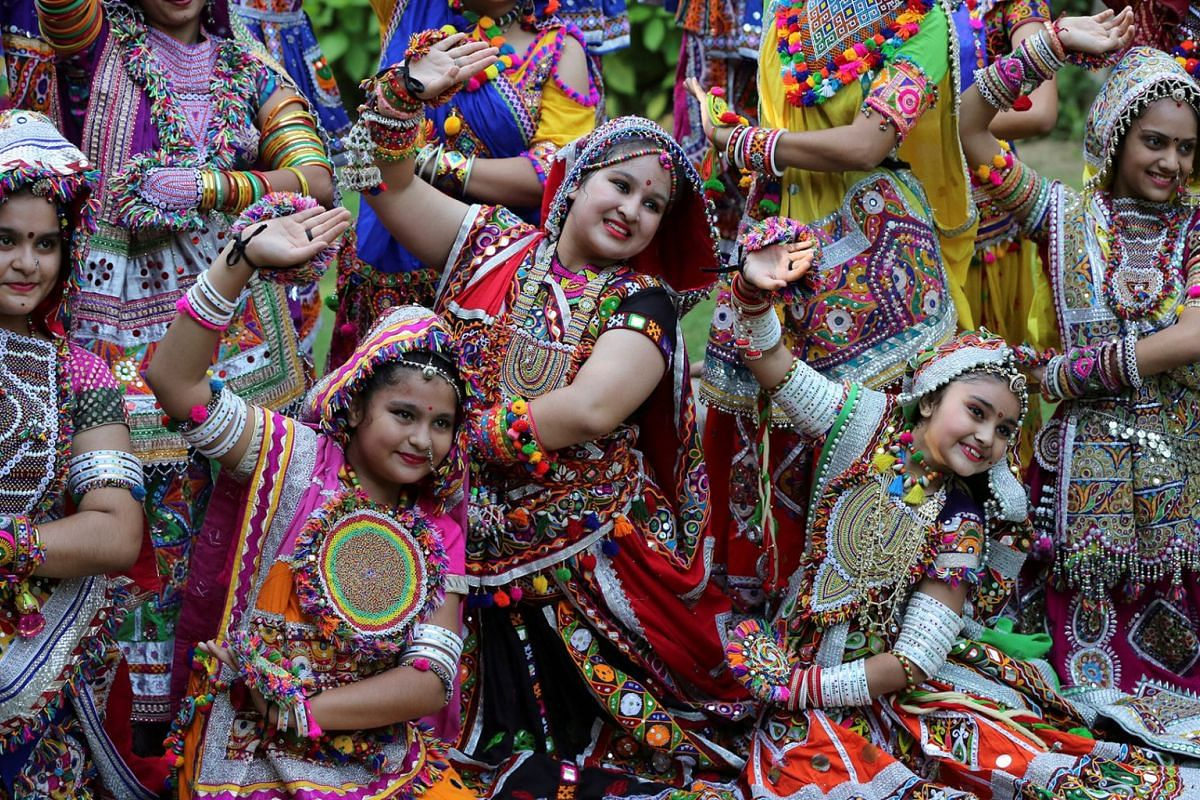 Participants dressed in traditional attire pose during rehearsals for Garba, a folk dance, ahead of Navratri, a festival during which devotees worship the Hindu goddess Durga and youths dance in traditional costumes, in Ahmedabad, India, Sept 30, 201