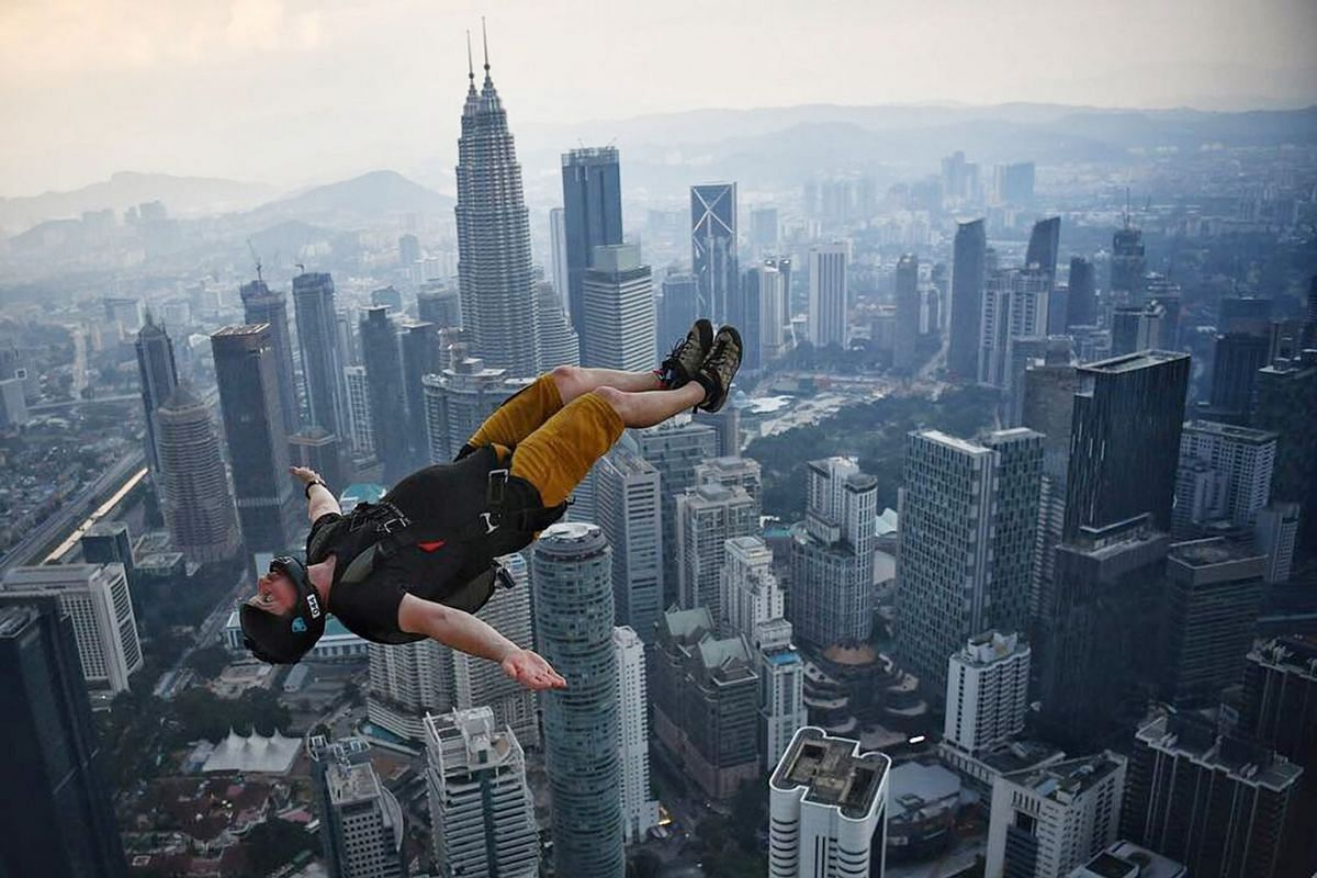 Thrill seekers leaping off KL Tower during the International Jump Malaysia (KLTIJM). The yearly event, which has been on going since 1999, has attracted hundreds of BASE jumpers from all over the world.