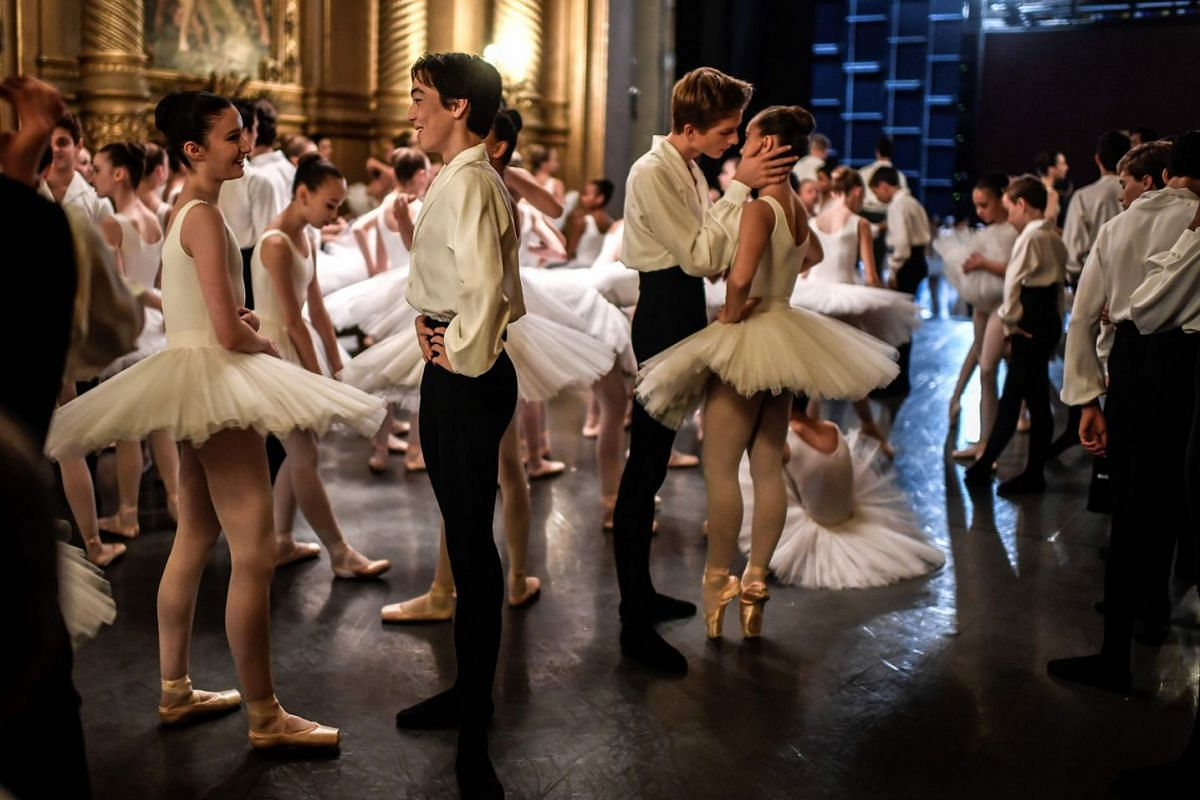 Dancers get ready on Sept 27, 2018 prior to the opening of the annual gala at the Opera Garnier in Paris. A relaxed atmosphere reigns behind the scenes of the Opéra Garnier a few minutes before the traditional parade of the Paris Opera Ballet at the