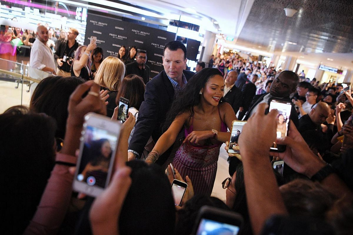 Pop star Rihanna arrives at Sephora Ion Orchard to celebrate the anniversary of her make-up line Fenty Beauty on Oct 1, 2018.