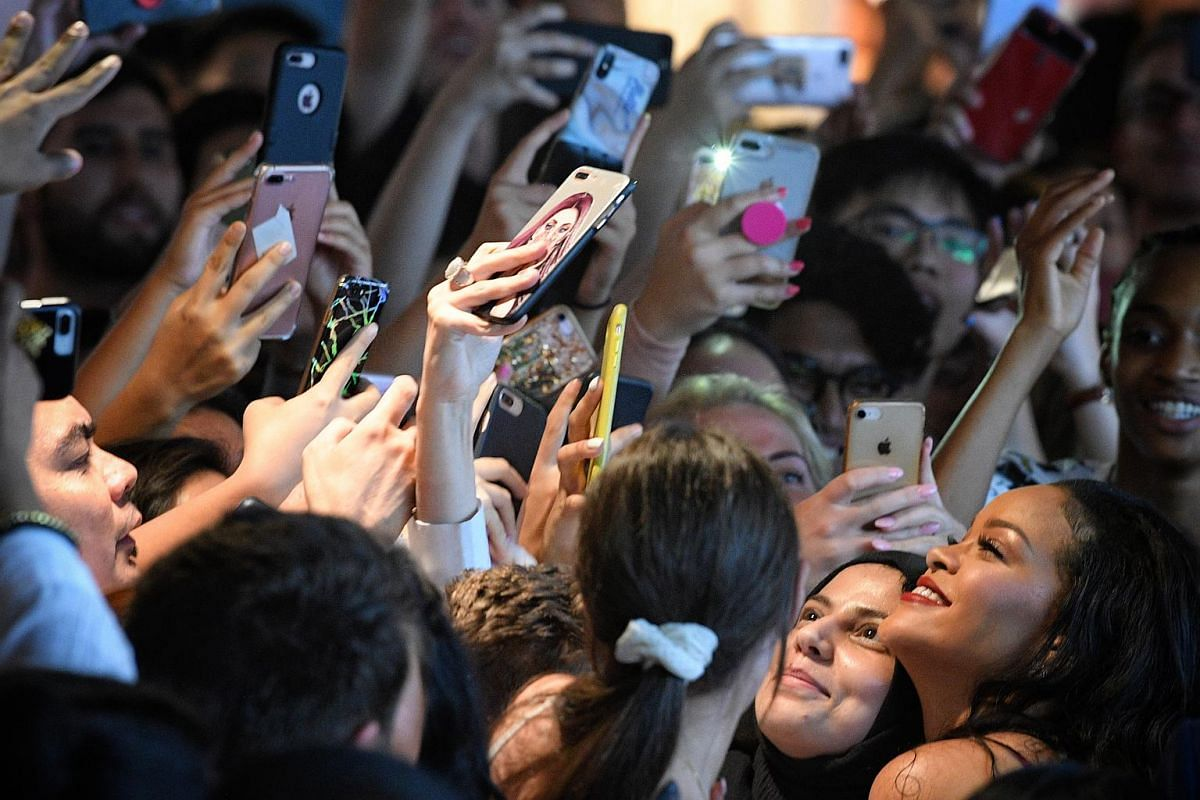 Rihanna taking wefies with fans at Sephora Ion Orchard during a surprise appearance on Oct 1, 2018.