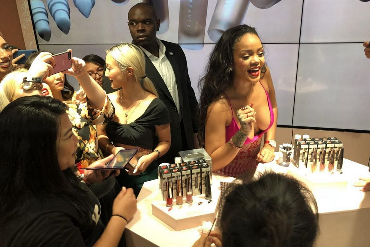 Rihanna mingling with fans and customers at Sephora Ion Orchard during a surprise appearance on Oct 1, 2018.