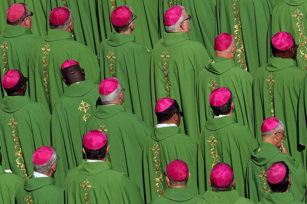 Bishops attend a mass for the opening of a synodal meeting in Saint Peter's square, at the Vatican, October 3, 2018.