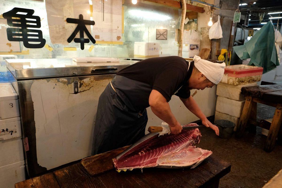 A vendor at a wholesale tuna store in Tsukiji.