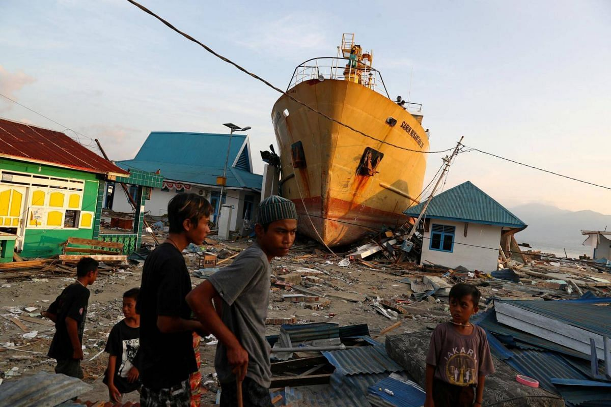 A ship, the KM Sabuk Nusantara 39, which had been pushed ashore by the tsunami, is seen tucked between buildings in Wani, Donggala, in Central Sulawesi, on Oct 3, 2018.