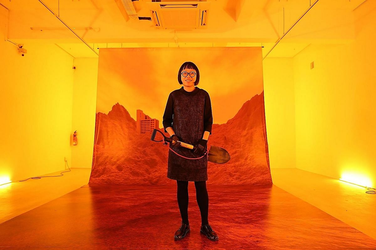 Artist and lecturer Debbie Ding collected soil from more than 20 locations all over Singapore for her exhibition, titled Soil Works.