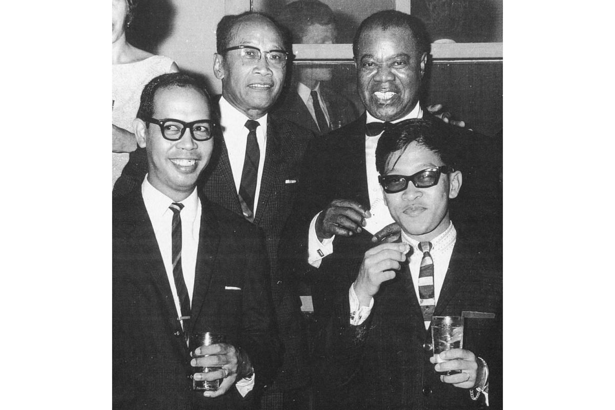 The Soliano clan with legendary jazz trumpeter Louis Armstrong at the US Embassy, Singapore, 1964.