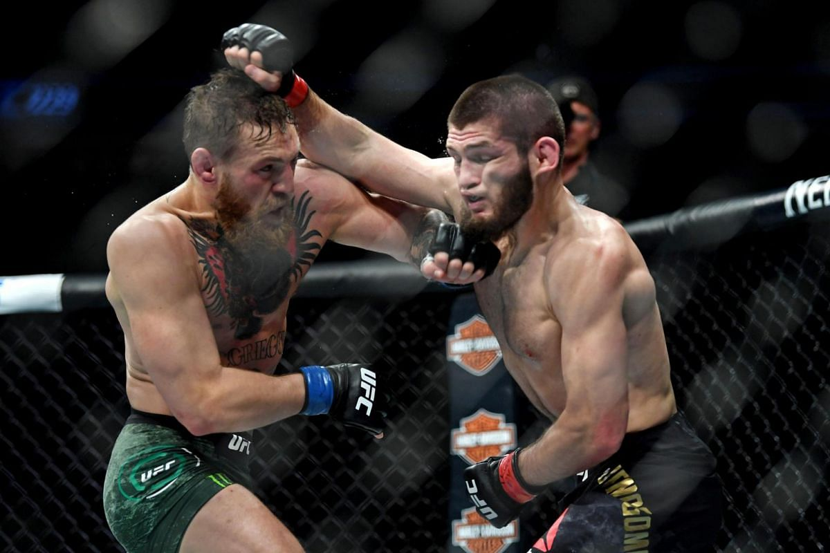 Nurmagomedov (right) and McGregor exchanging blows during their highly anticipated bout.