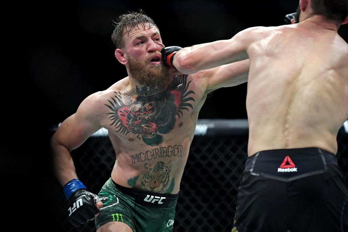 McGregor takes a punch in the face from Russian opponent Nurmagomedov.
