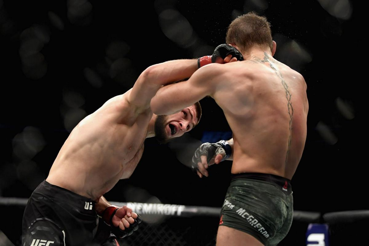Nurmagomedov scoring another punch against controversial opponent McGregor during their bout.